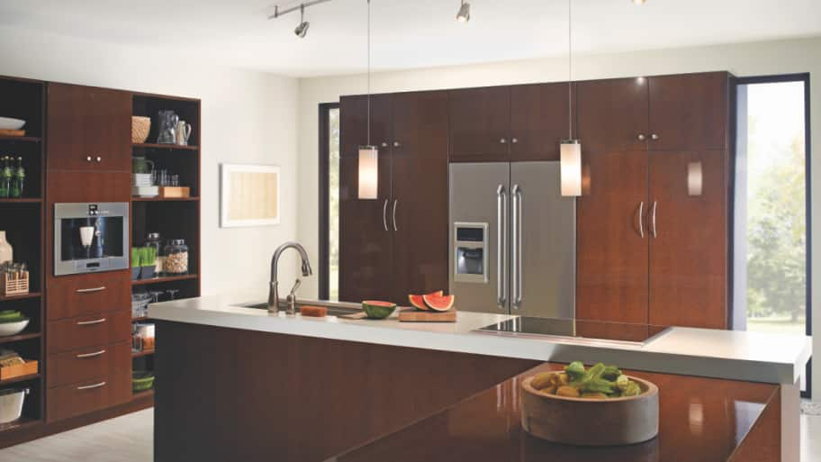 the hanging pendants on this track show off the kitchen island photo courtesy of tech lighting