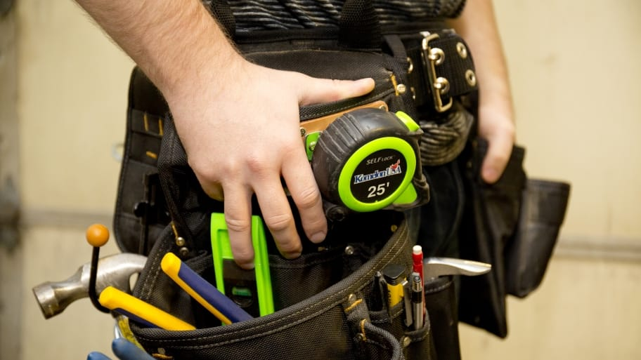 guy with toolbelt full of tools
