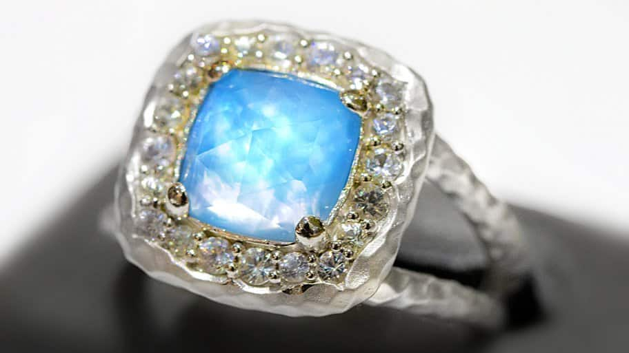 white sapphire halo with mother of pearl and turquoise center