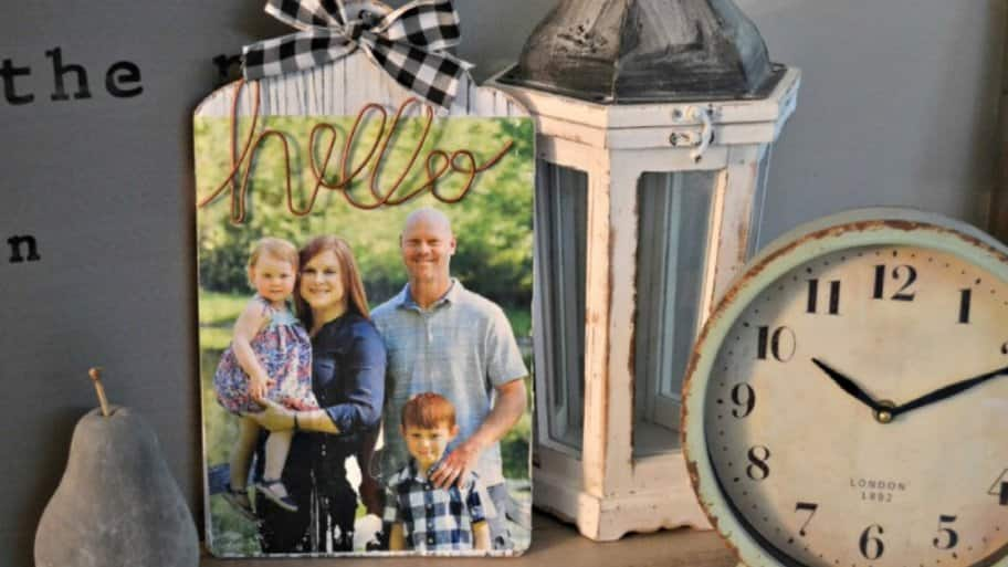 Rustic wood photo with clock and lantern