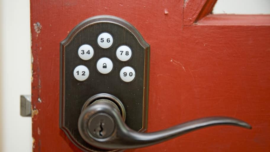 Red door with keyless lock in the handle.