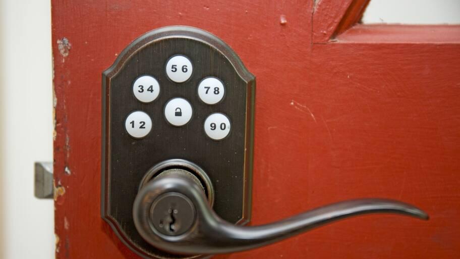 red door with keyless lock in the handle