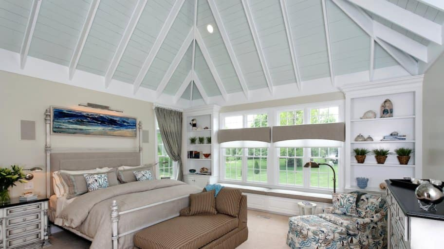 stylish bedroom with coffered ceiling