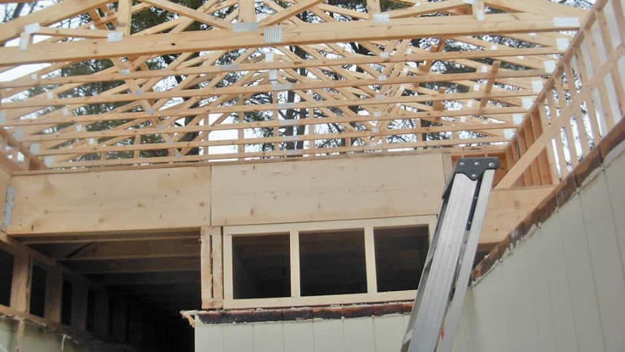 home addition in progress with exposed studs and framing