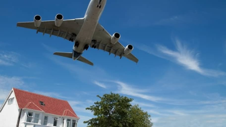 Focusing on the positive attributes of a house help distract potential buyers from any negatives, such as living close to an airport. (©Thinkstock)