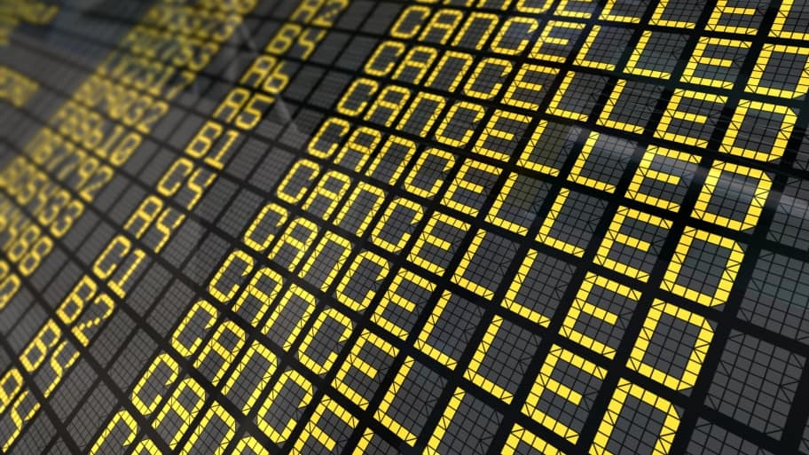 an airport's flight board listing out cancellations