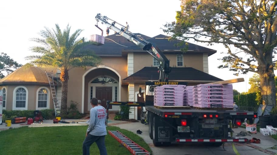 Nice Roofing Contractors Working On Home