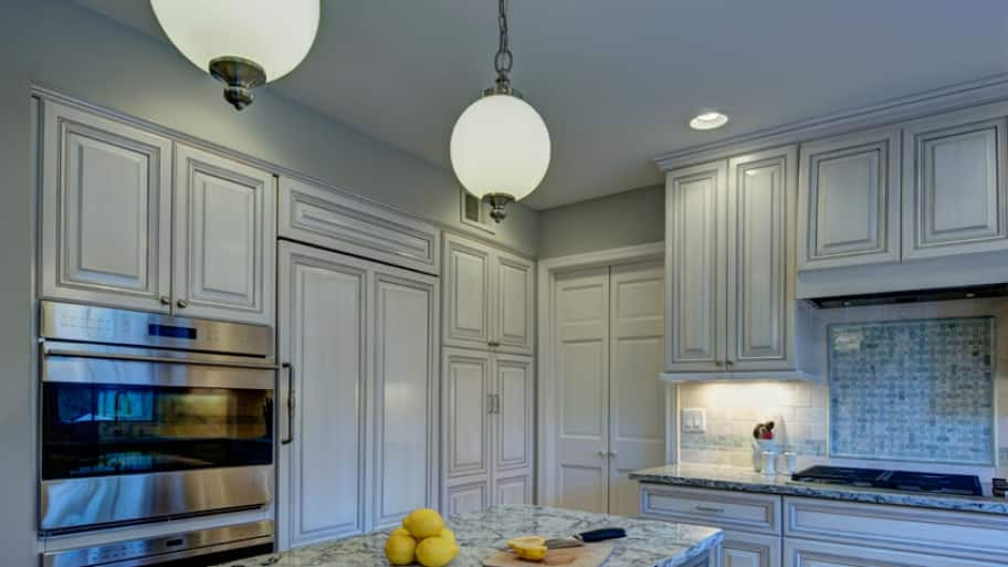 Ambient lighting is important with an open floor plan, where you want the kitchen and its lighting to fit in with the rest of your home. (Photo courtesy of Moss Building & Design)