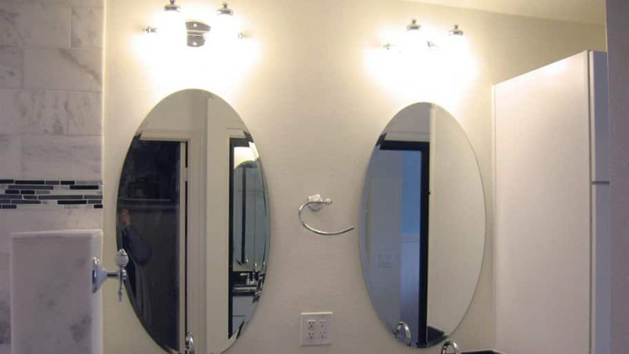 Dual vanities with sinks and sconce lighting