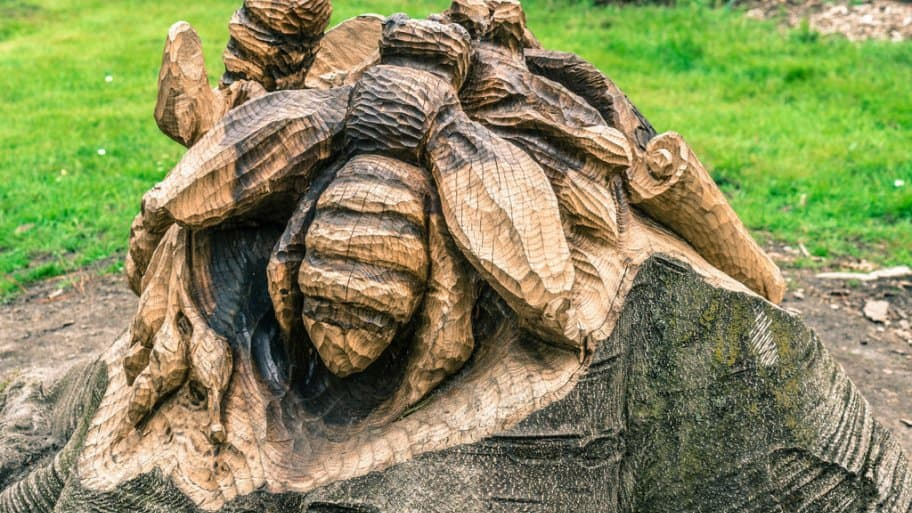 A tree stump carving of bees