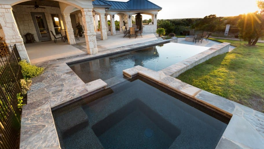 Spa And Lap Pool With Stone Patio