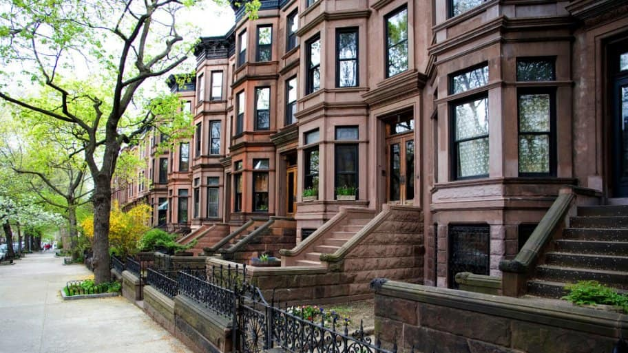 Row Of Brownstone Buildings Have A