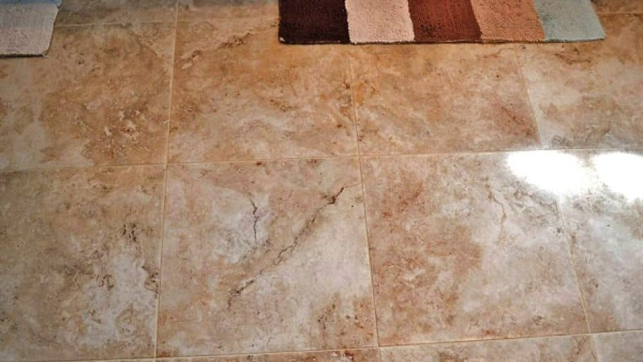 Larger, neutral-colored tiles remain a popular choice for both bathroom floors and walls. (Photo courtesy of Angie's List member Melissa B., of Euless, Texas)