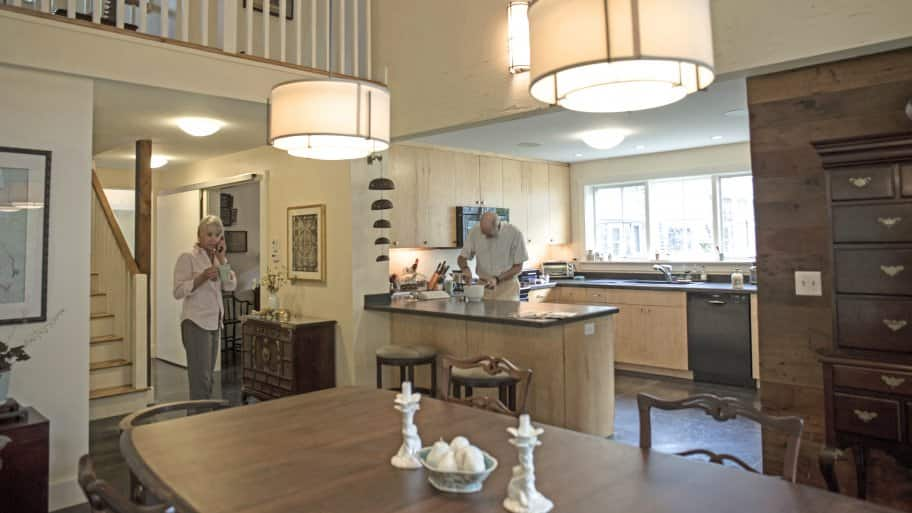 Jane Covey And Husband Dave Brown Stand In Their Remodeled Kitchen And  Dining Area, Which