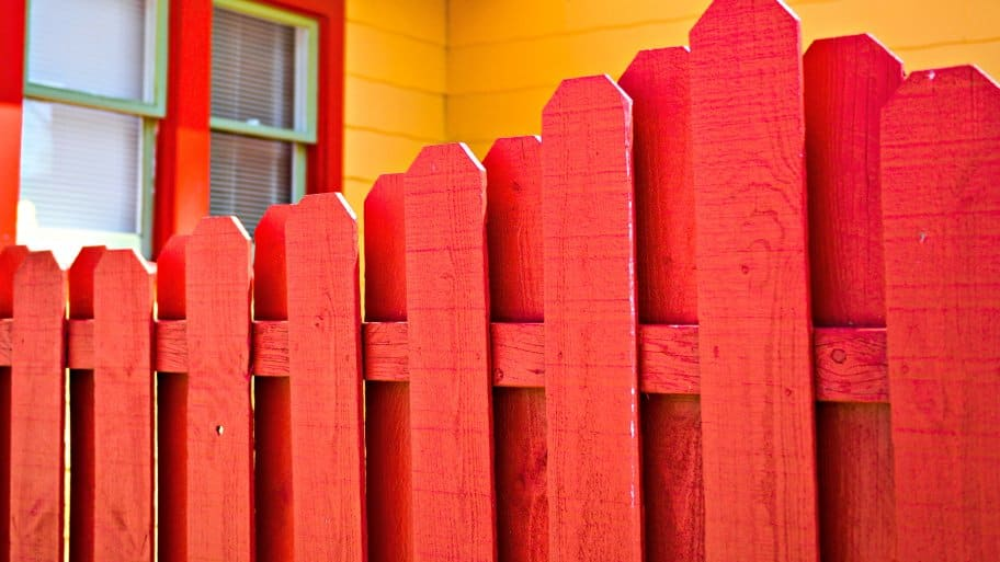 wood fence painted red