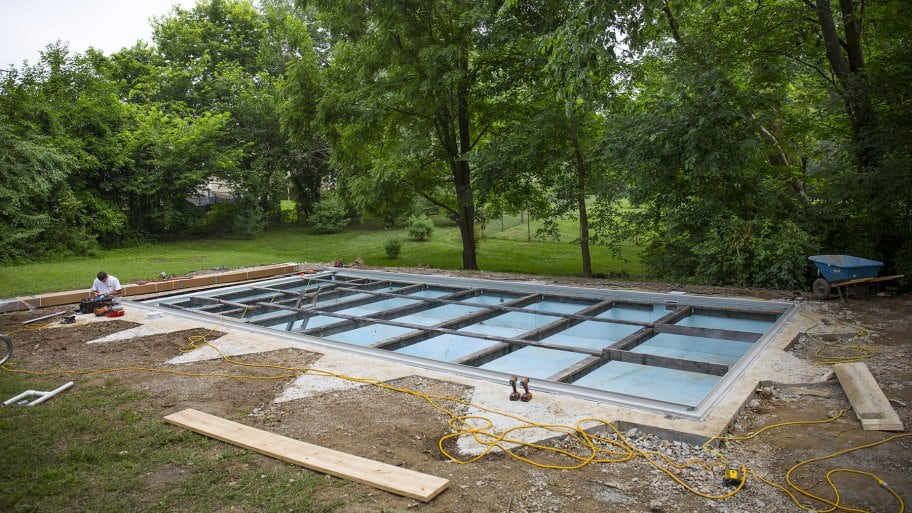 The base is poured around the fiberglass pool, the deck will be poured next. (Photo by Eldon Lindsay / Angie's List)