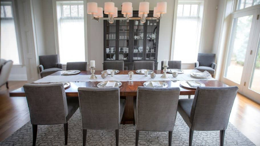 Eight Person Dining Table Gray Tones Hardwood Floors Chandelier