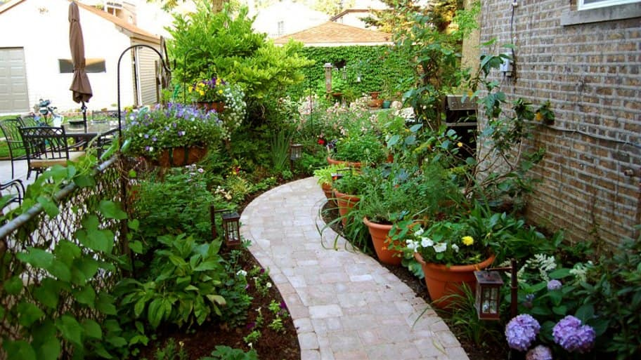 Even Small Yards Can Be Transformed By Layering Your Plants. (Photo  Courtesy Of Member