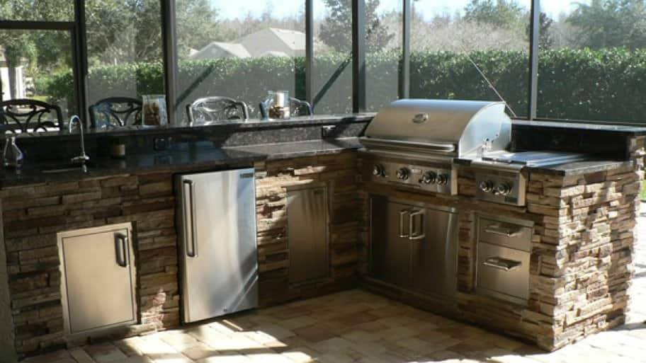 Your outdoor kitchen should be built close to your existing house to make it easier for wiring electricity and plumbing to that location, says Wood. (Photo courtesy of Angie's List member Richard J. of Tampa, Fla.)