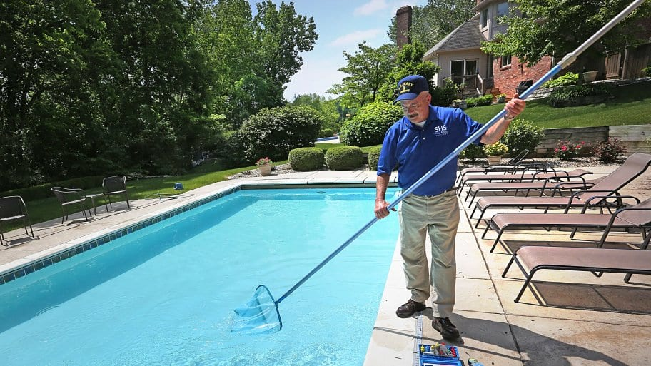 Bob Stalcup, pool specialist with SHS Pool & Spa Service and Supply. Using his skim net which is a flat mesh net that attaches to the tele pole. (Photo by Frank Espich /Angie's List)