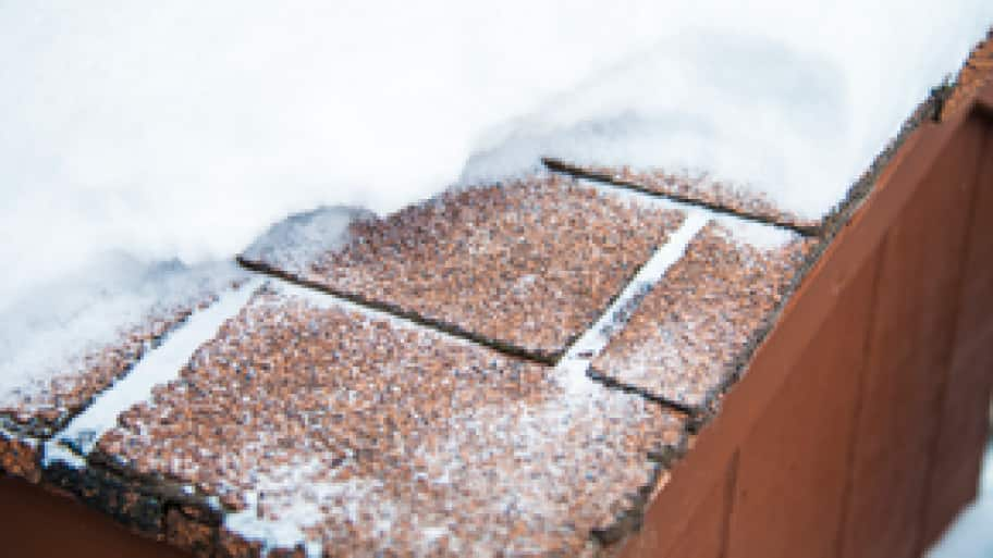 snow melting on a roof