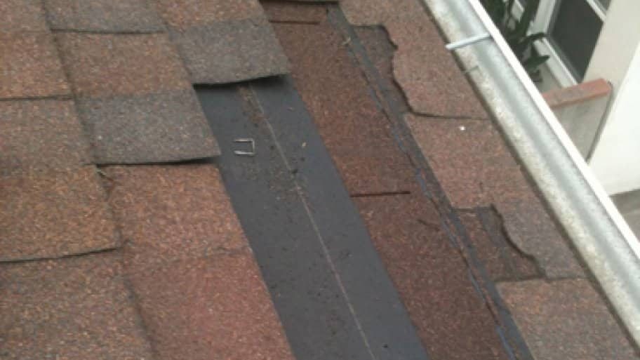 While most roofs can withstand moderate winds, high winds can cause damage such as blown-off asphalt shingles. (Photo courtesy of Chandler's Roofing)