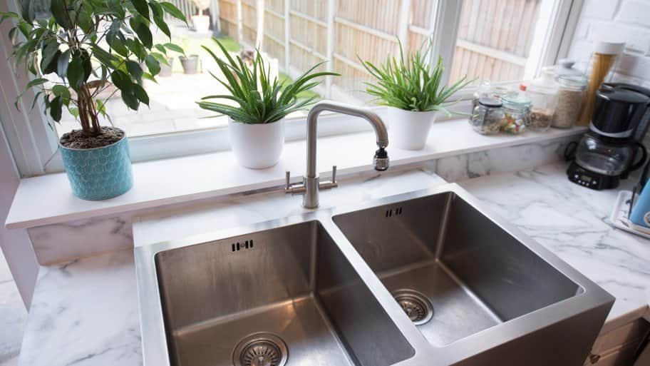 a metal kitchen sink