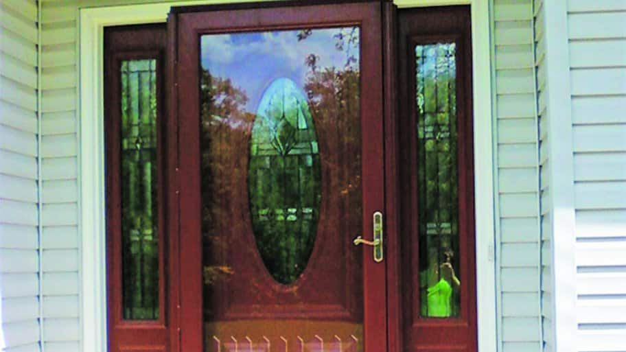 red storm door on home (Photo by Angie's List)