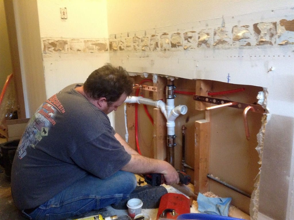 Plumber Working On Kitchen Remodeling Project