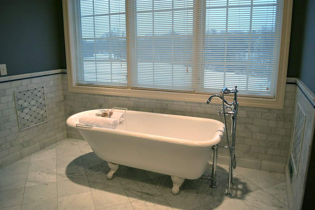 refinished bathtub in remodeled bathroom