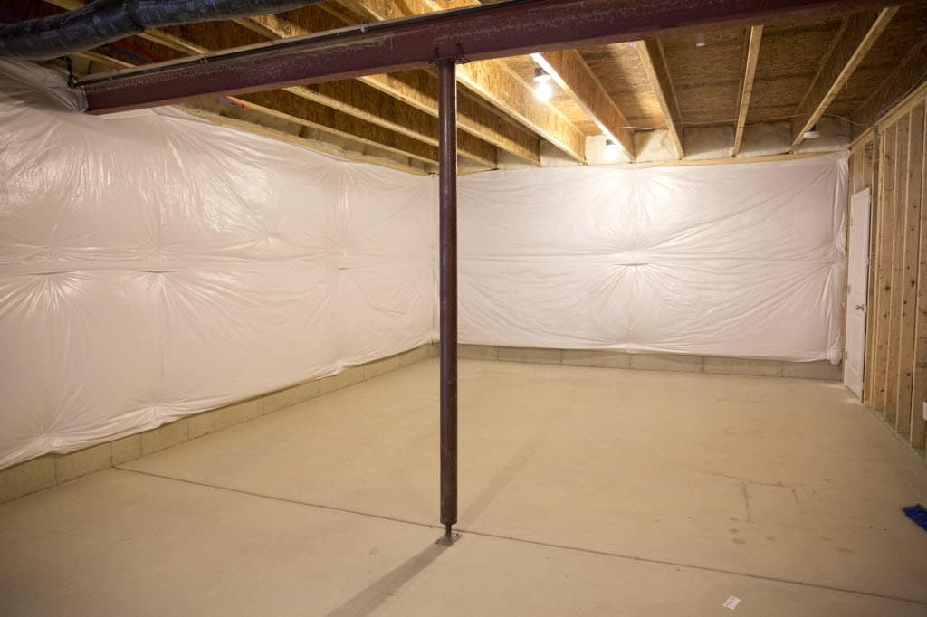 unfinished basement. Load bearing metal wall beam with supporting post in unfinished basement Basement Remodeling  Angie s List