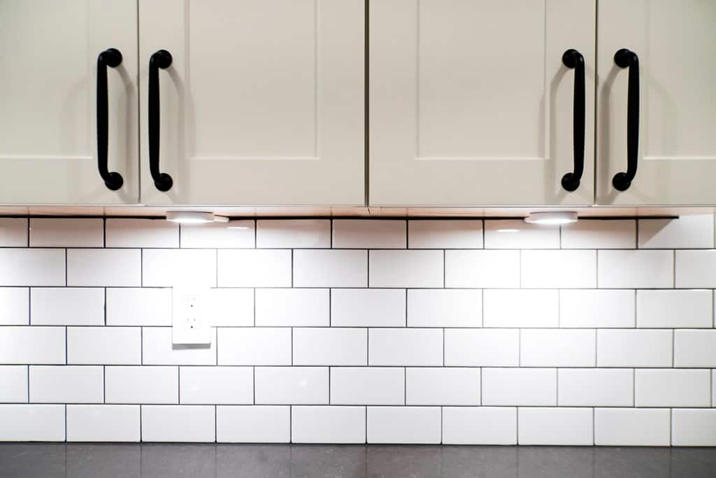 White kitchen cabinets with lighting & What are Melamine Kitchen Cabinets? | Angie\u0027s List kurilladesign.com