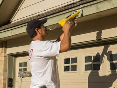 caulking gutter with caulk gun