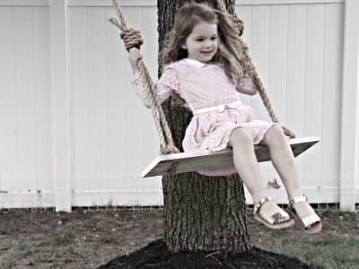 girl on rope tree swing