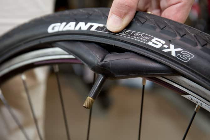 Removing the tire and tube from the bike wheel