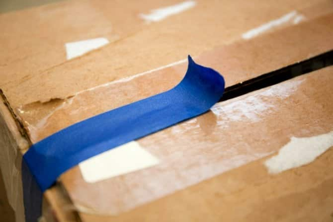 a cardboard box with blue packing tape