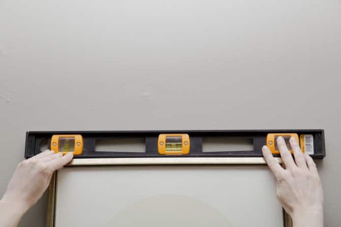 How to hang a picture (Photo by Eldon Lindsay)