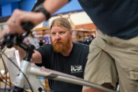 Scott Irons, owner of Indy Cycle Specialists in Indianapolis, demonstrates how to fit a rider to get a  comfortable ride.  (Photo by Brandon Smith)