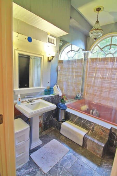 Featured on HGTV, Atlanta homeowner Brad Crosby's bathroom remodel includes a spa-like shower and a heated limestone floor with marbel accents. (Photo courtesy of Stephen Weatherby)