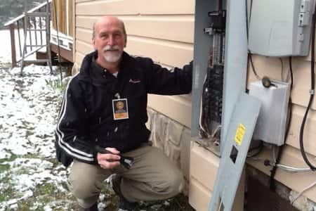home inspector with electric panel