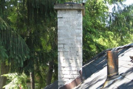 Chimney liners can deteriorate over time and brickwork can become dislodged due to water damage and temperature changes. (Photo by Mike LaFollette)