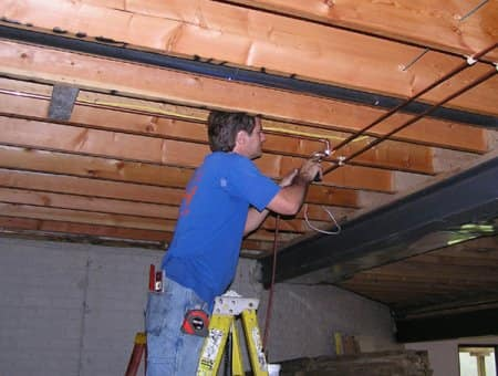 Plumber working on pipes