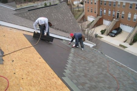 roofers installing shingle roof