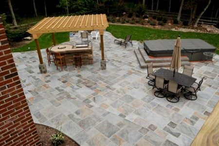 A Stamped Concrete Patio With Pergola A Hot Tub