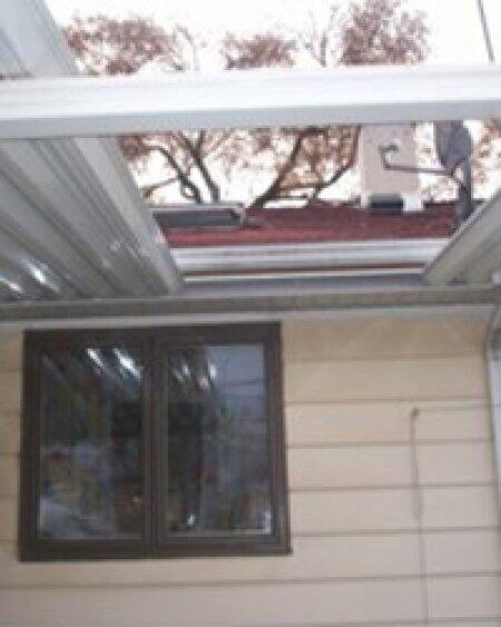 Illinois homeowner Susan Czach says Godfather Construction left a 2-foot gap in her awning and never started work on her siding. Local media covered her fight to expose the alleged scammers. Photo by Jay Madden.