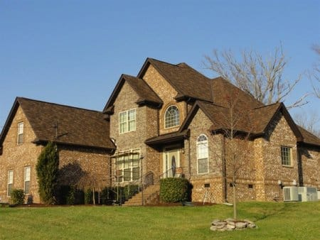 two-story brick home with new roof