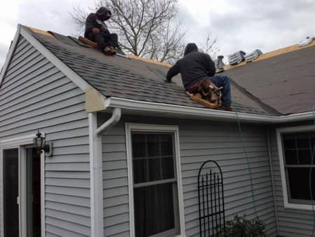 Crew On Roof Replacing Asphalt Shingles During Winter. Image Number 45 Of Sears  Roofing .