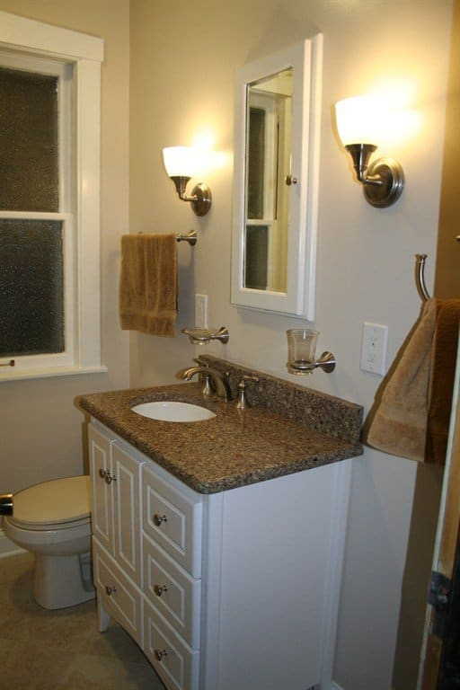 bathroom remodel with new cabinets and countertops