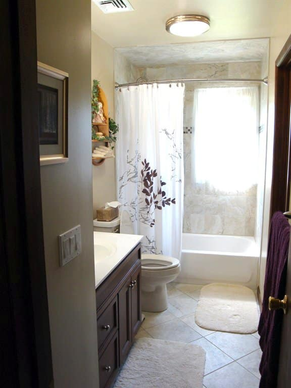 bathroom remodel with new tile floor and cabinets