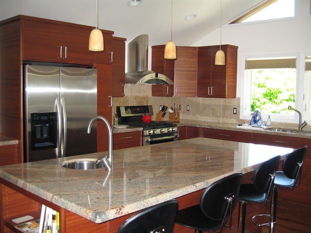 kitchen remodel with granite countertops and stainless steel appliances